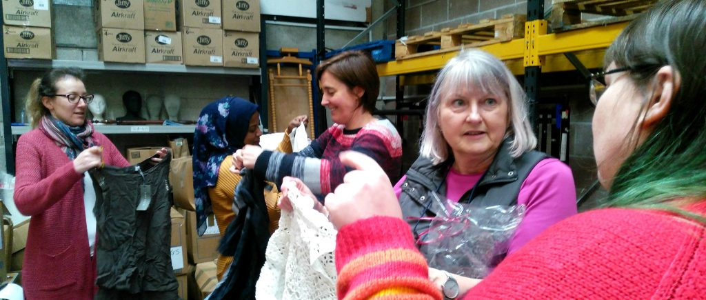WCVA staff sorting clothing at the Tenovus Cancer Care warehouse as part of our Employer Supported Volunteering scheme