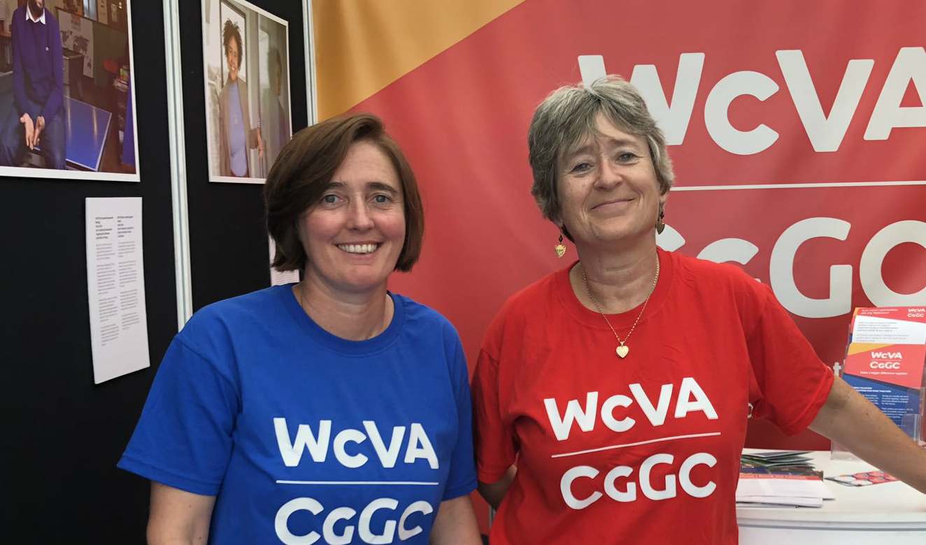 Two beaming women wearing t-shirts that read WCVA CGGC