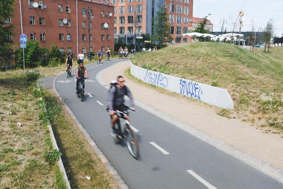 People cycling down a bike lane