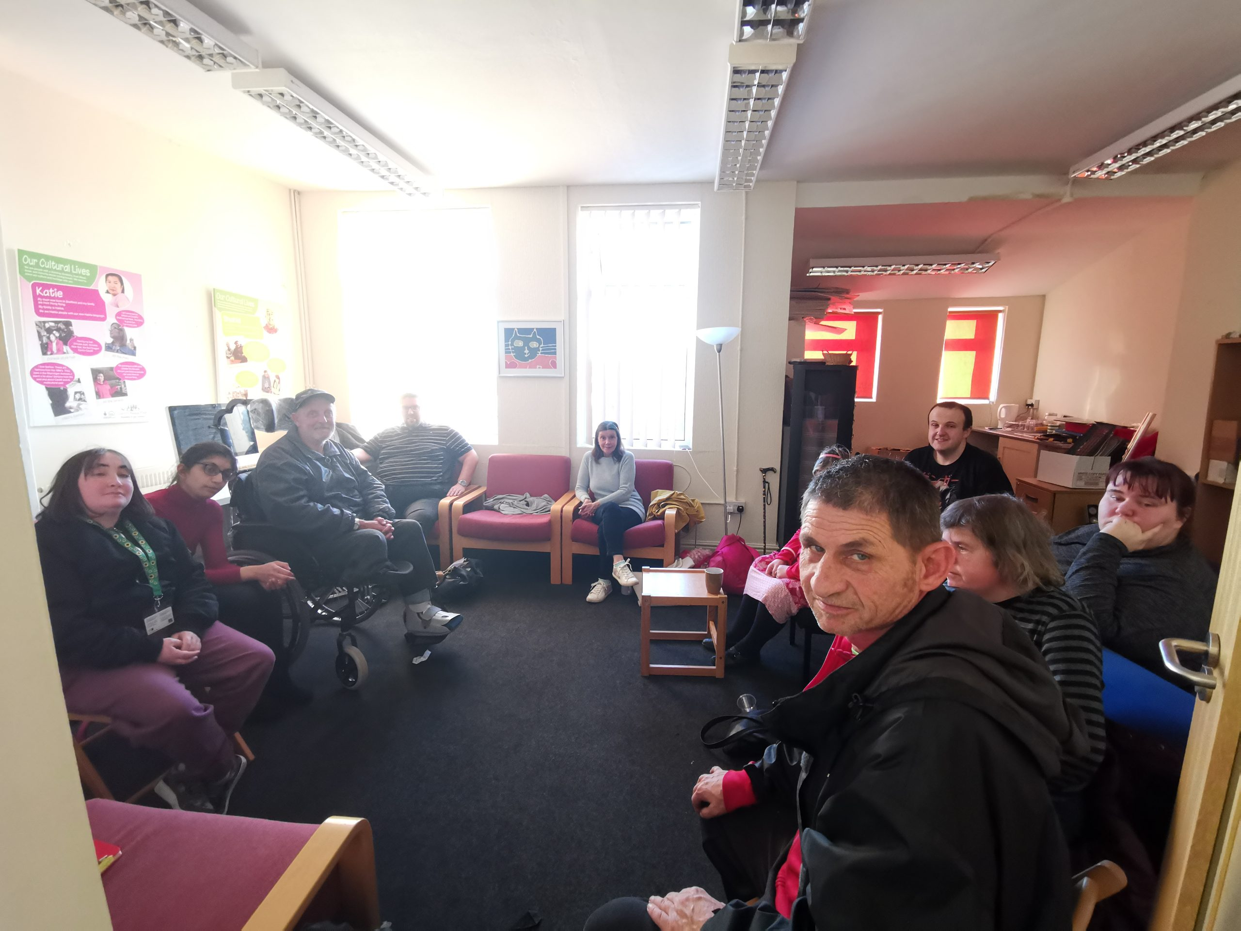 People sitting at Cardiff People First offices