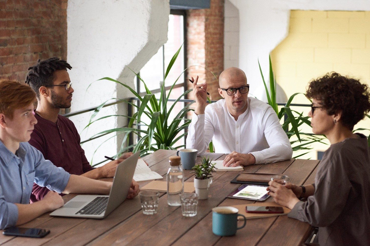 Group of people strategising at meeting table