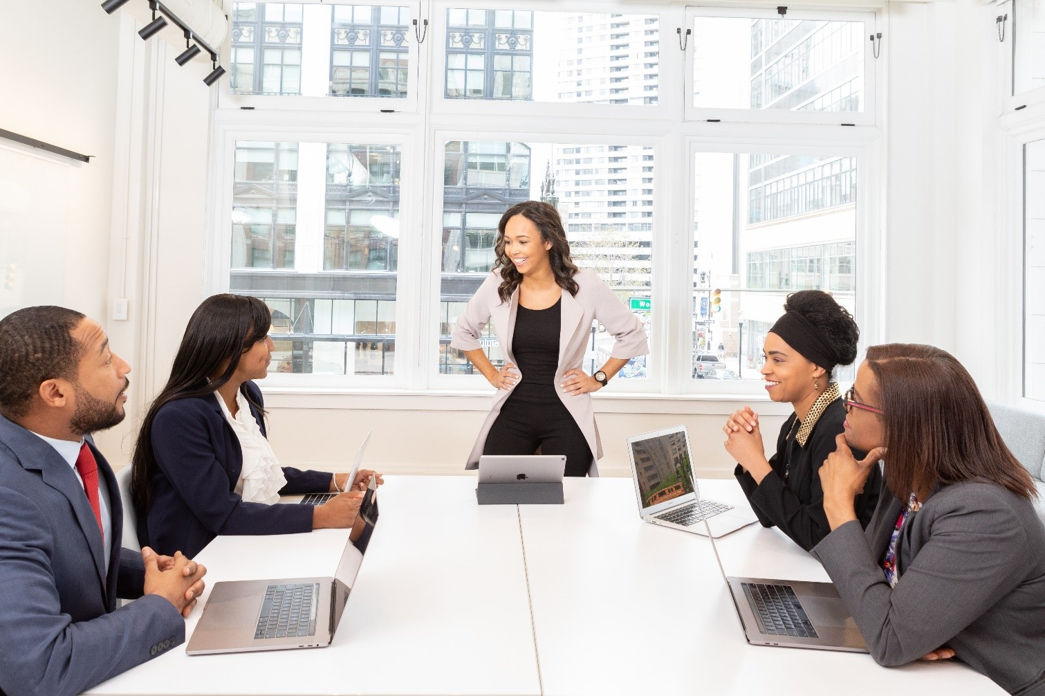 Smartly dressed people in white meeting room