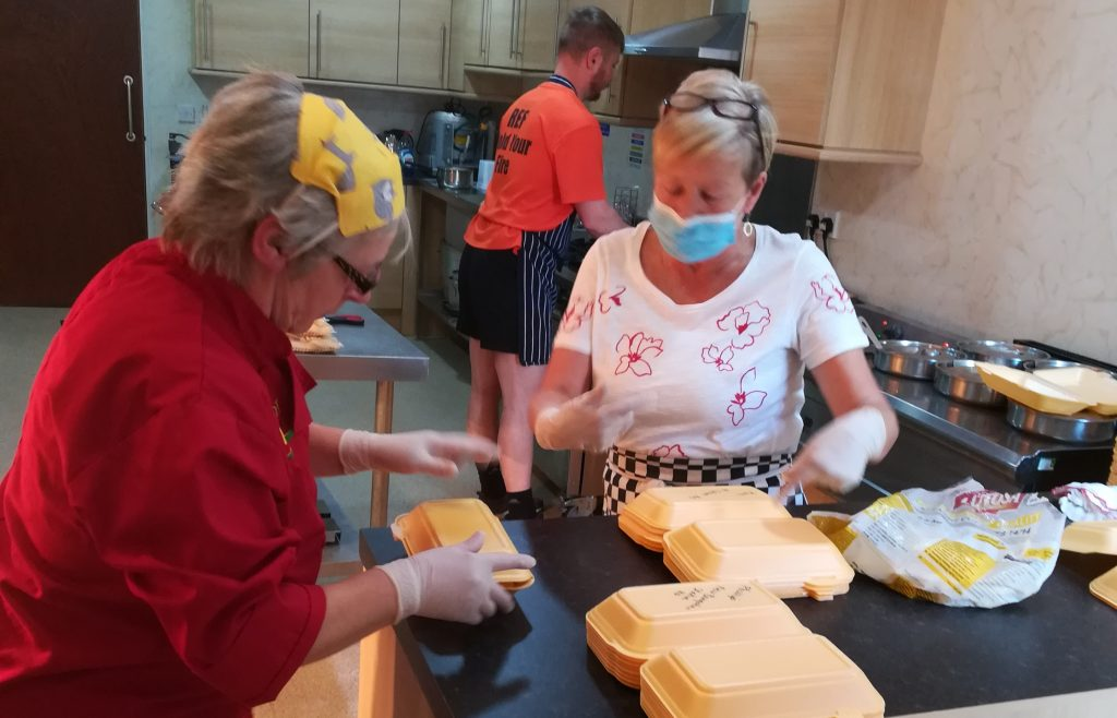 Staff at talbot community centre prepare meals for delivery