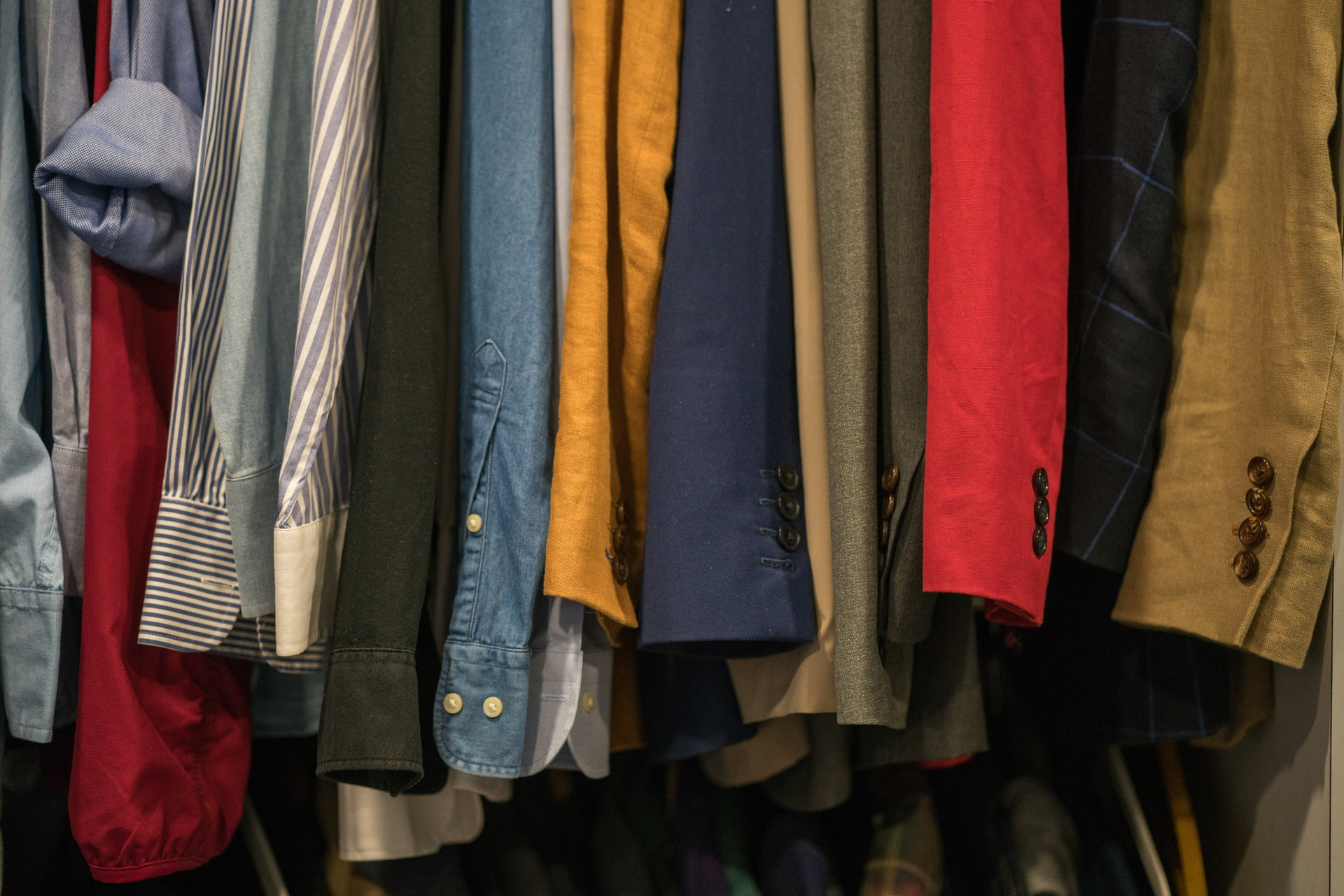 assorted clothes on charity shop rail