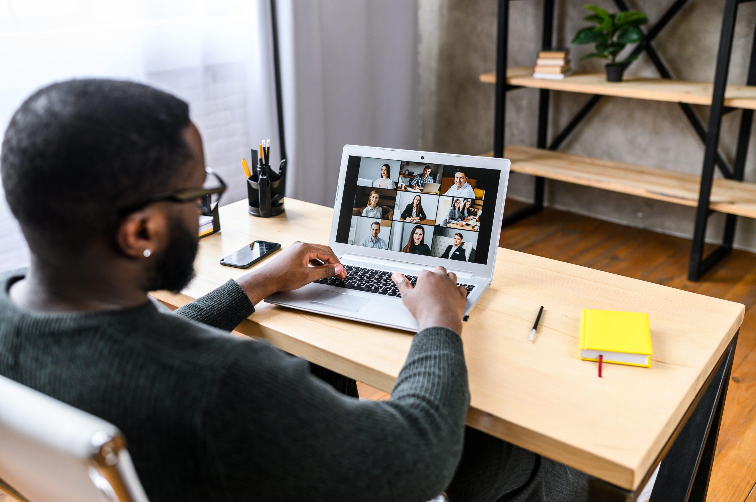 Man sits in online meeting