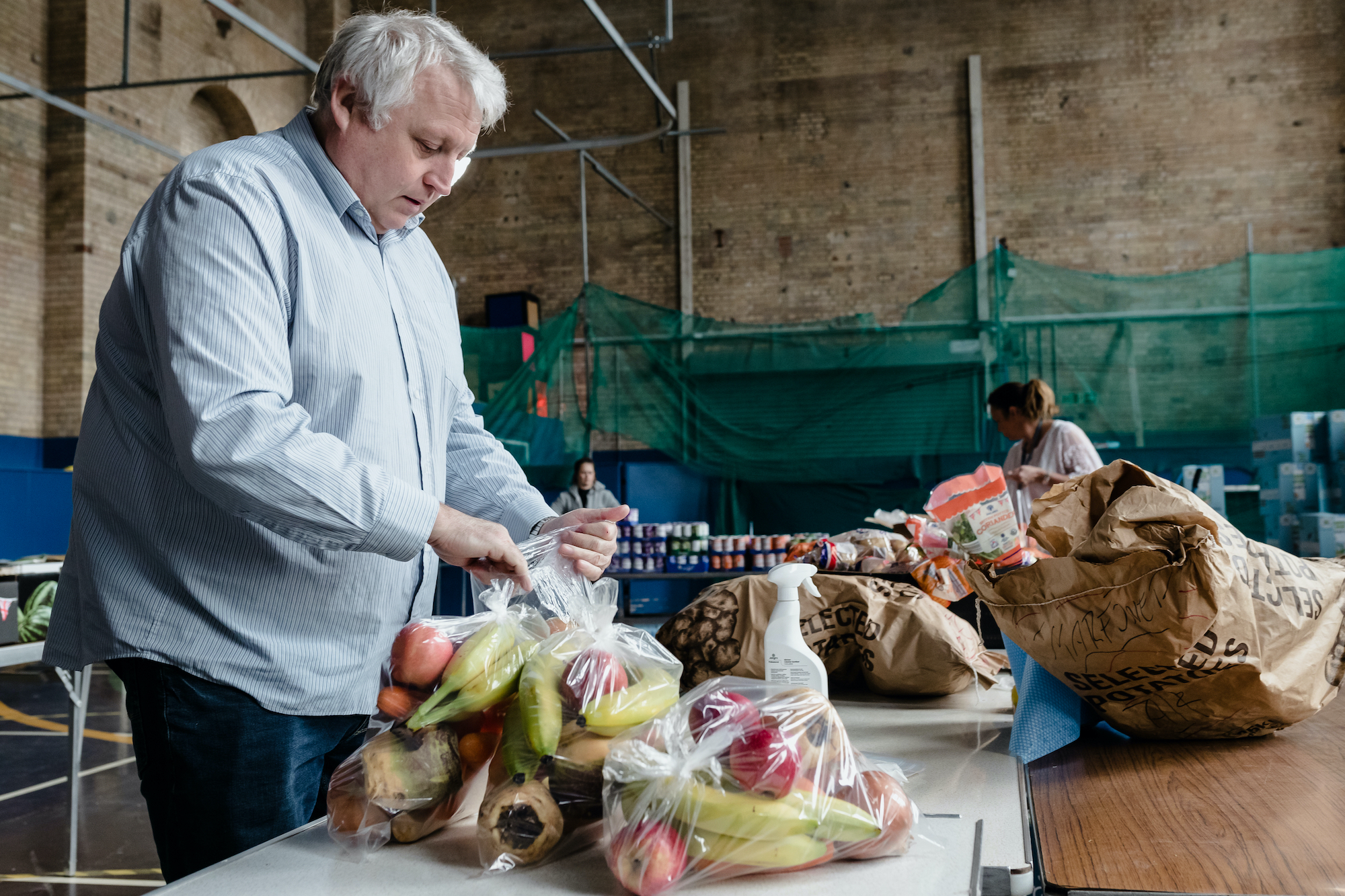 Volunteer packing food parcels