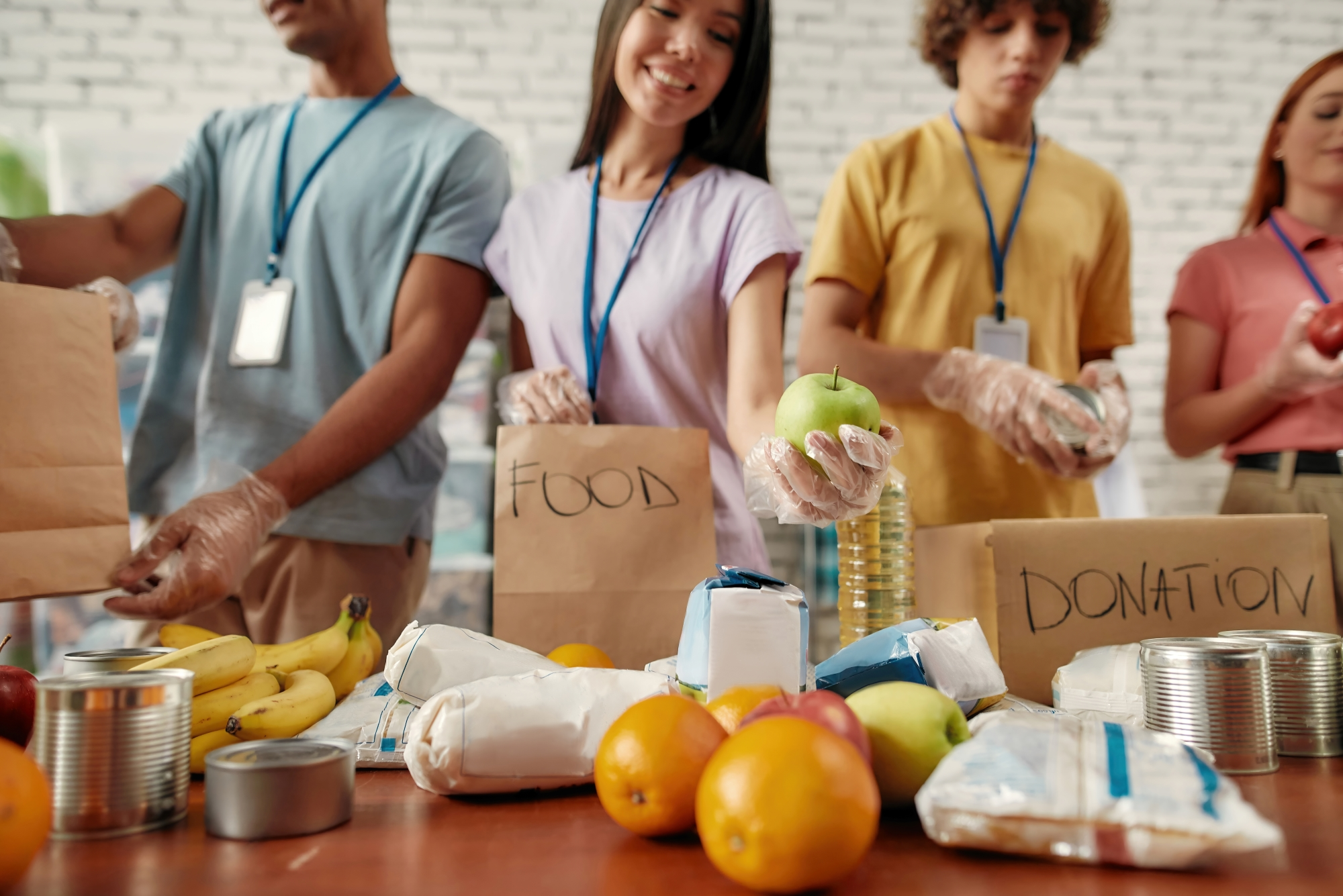 Young people volunteering to sort food donations
