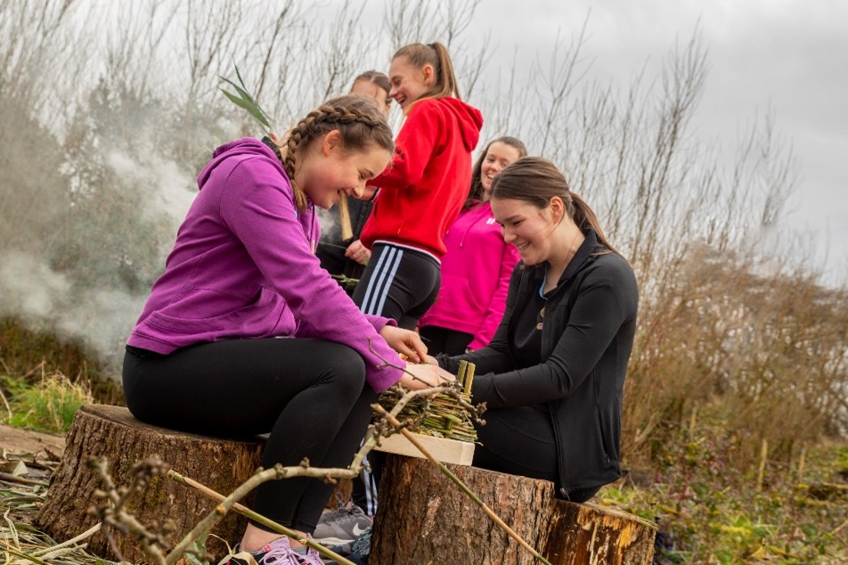 STEER participants create art from twigs in the forest