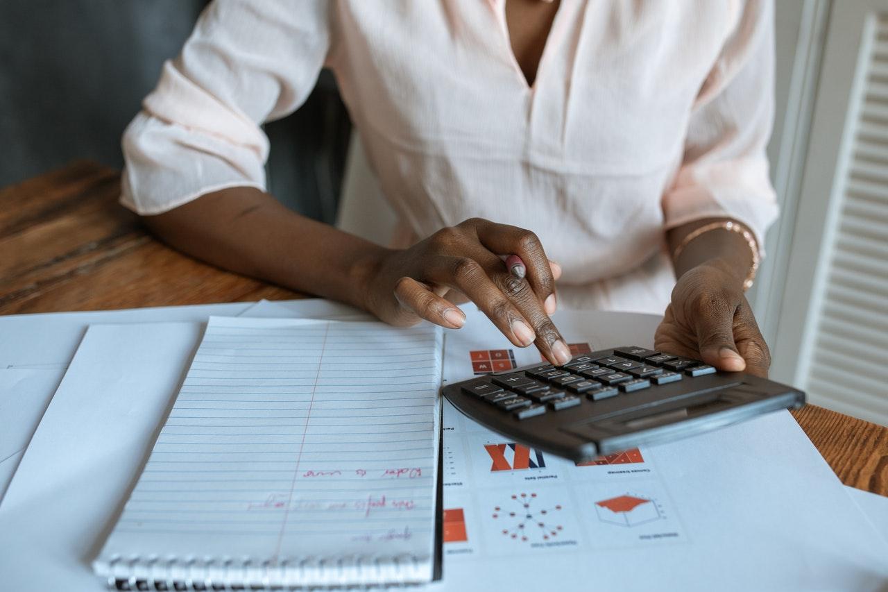 Man calculating figures