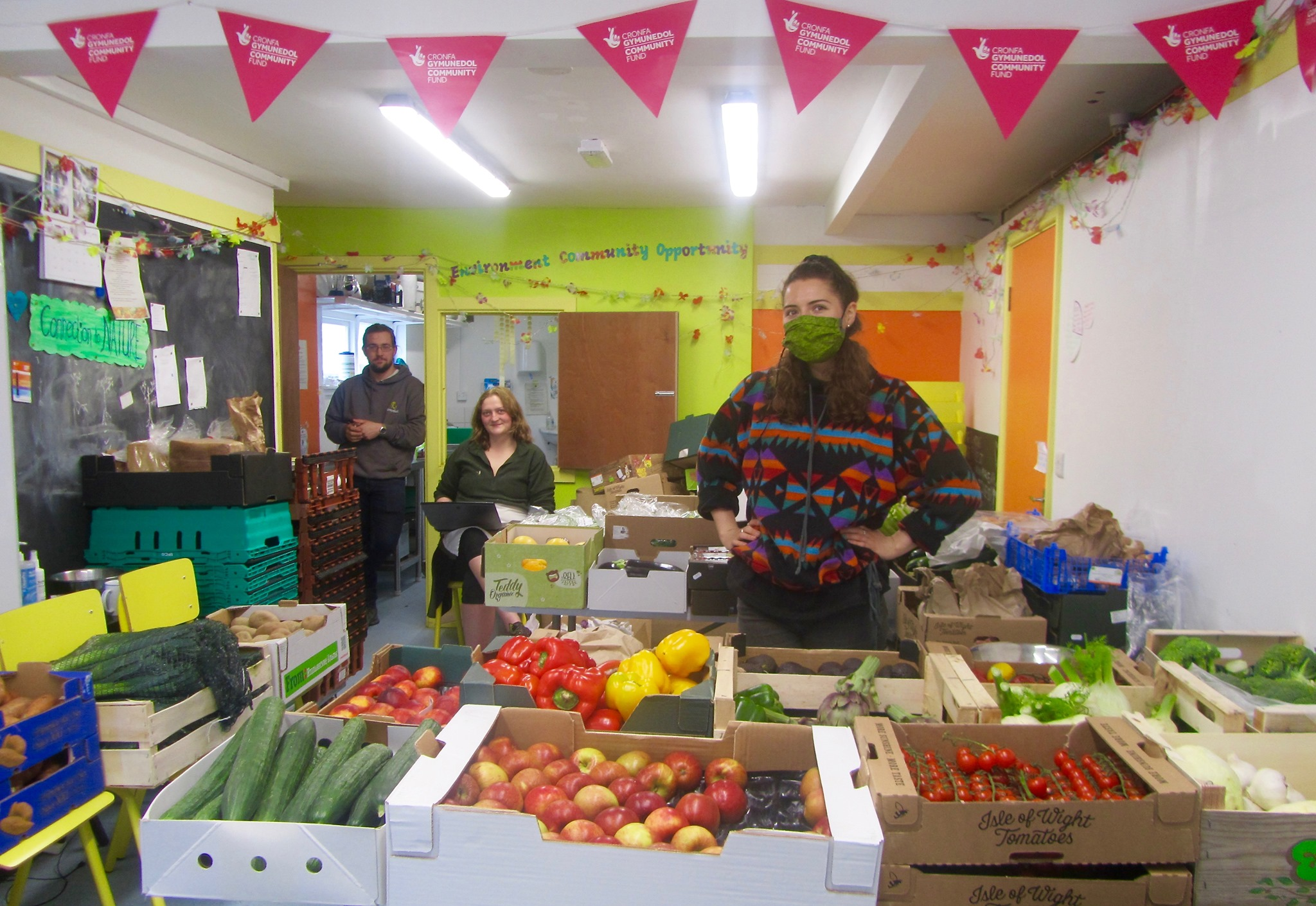 Aber Food Surplus staff stand surrounded by food gathered for redistribution