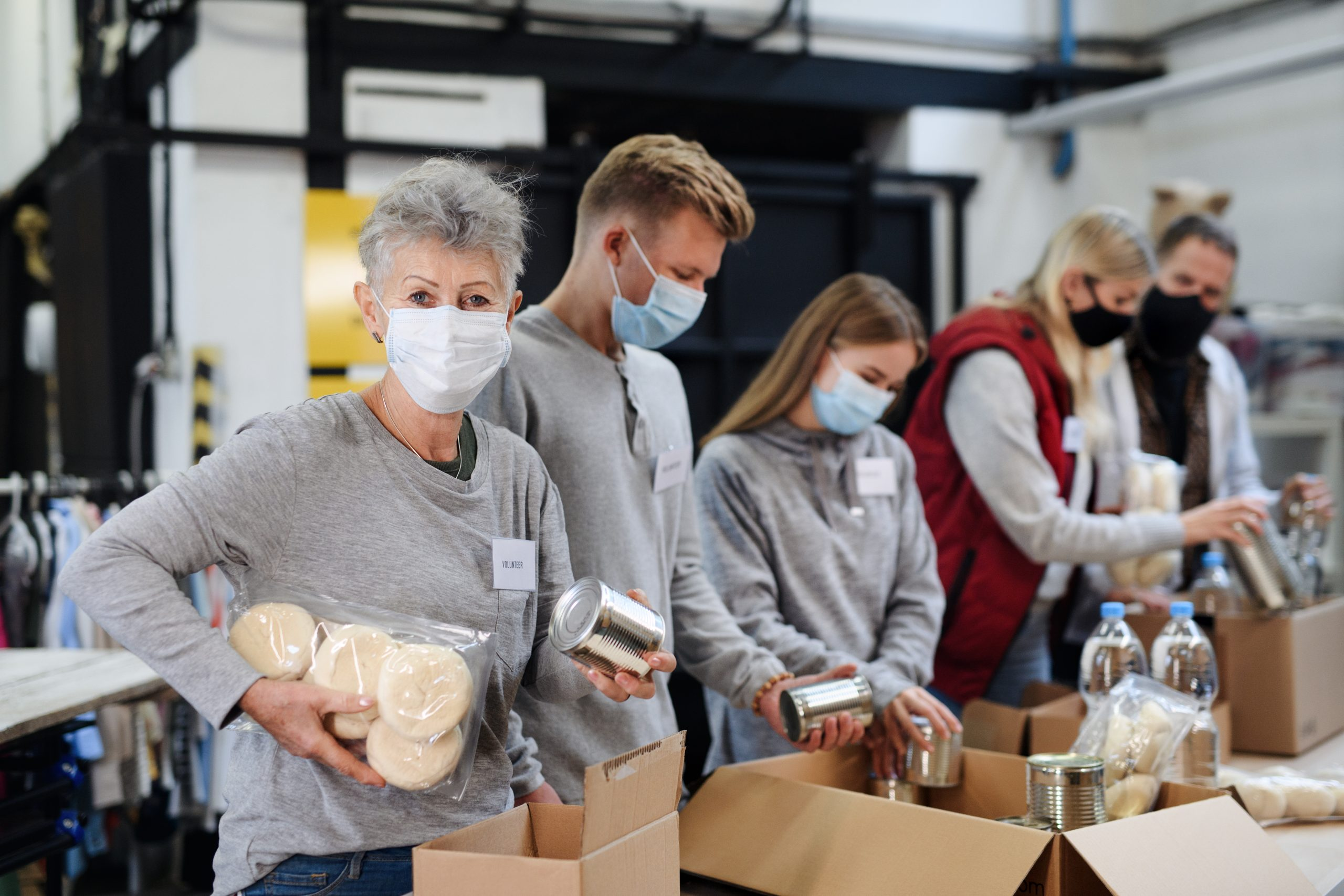 Volunteers packing food boxes