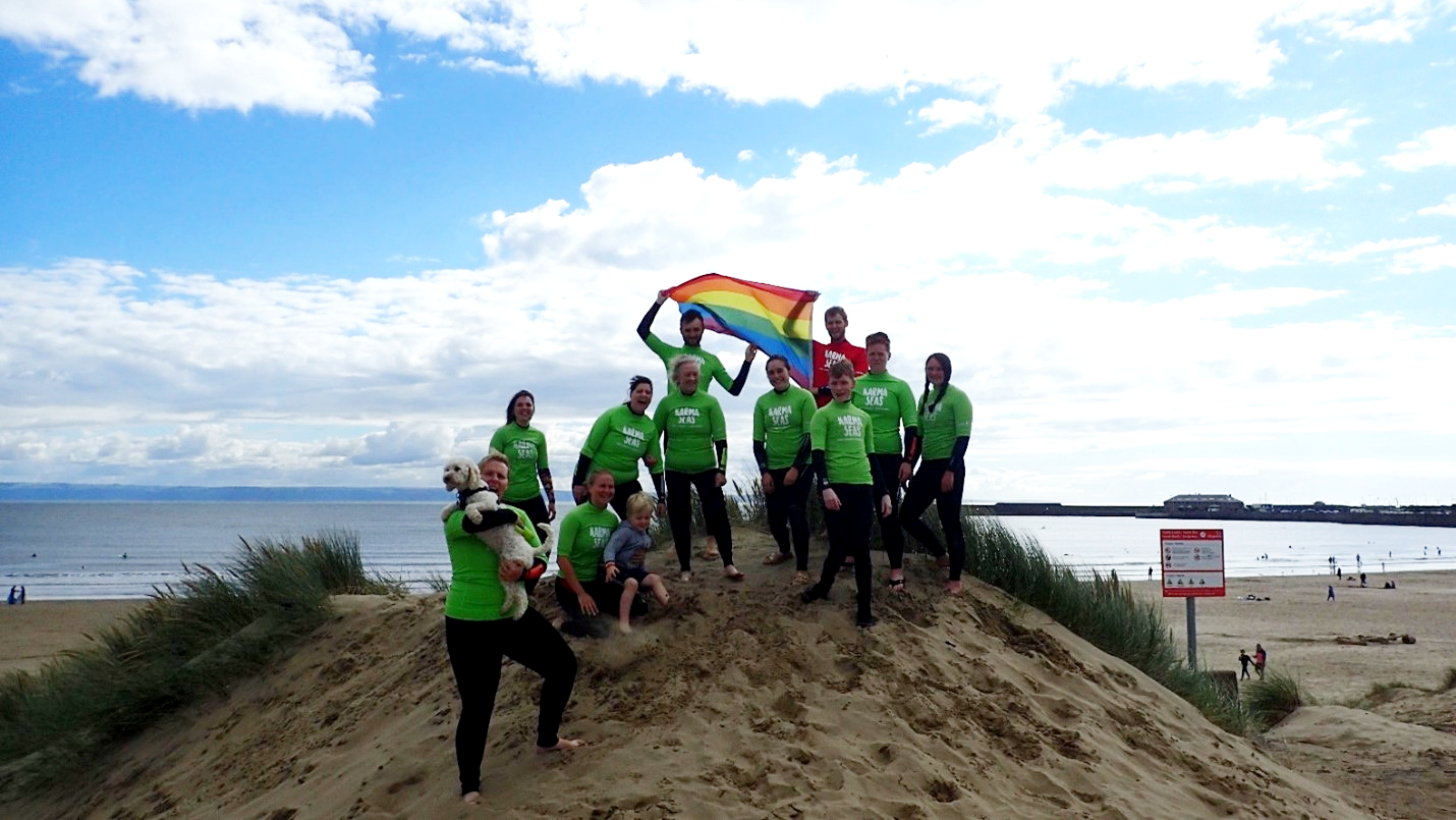 A group of people standing on sand dunes